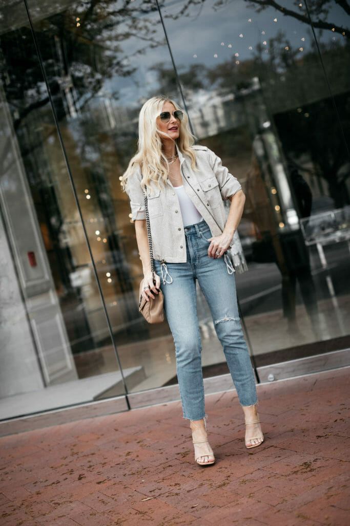 Style blogger wearing a neutral jacket and denim