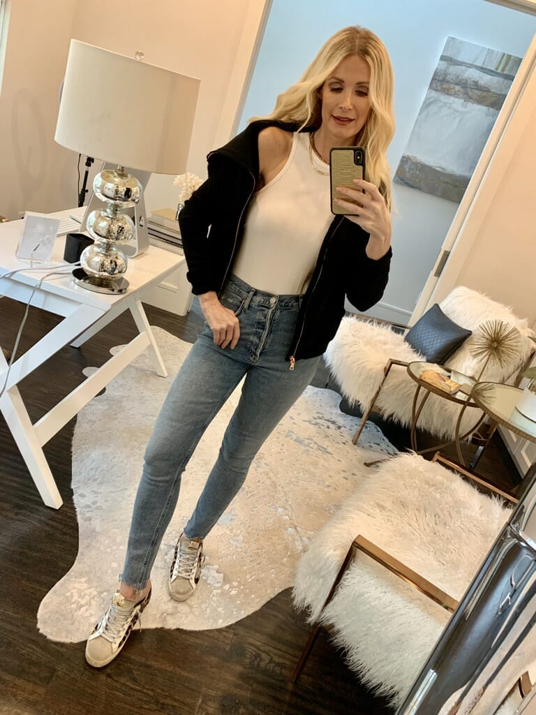 Dallas blogger wearing a white tank and denim and sneakers