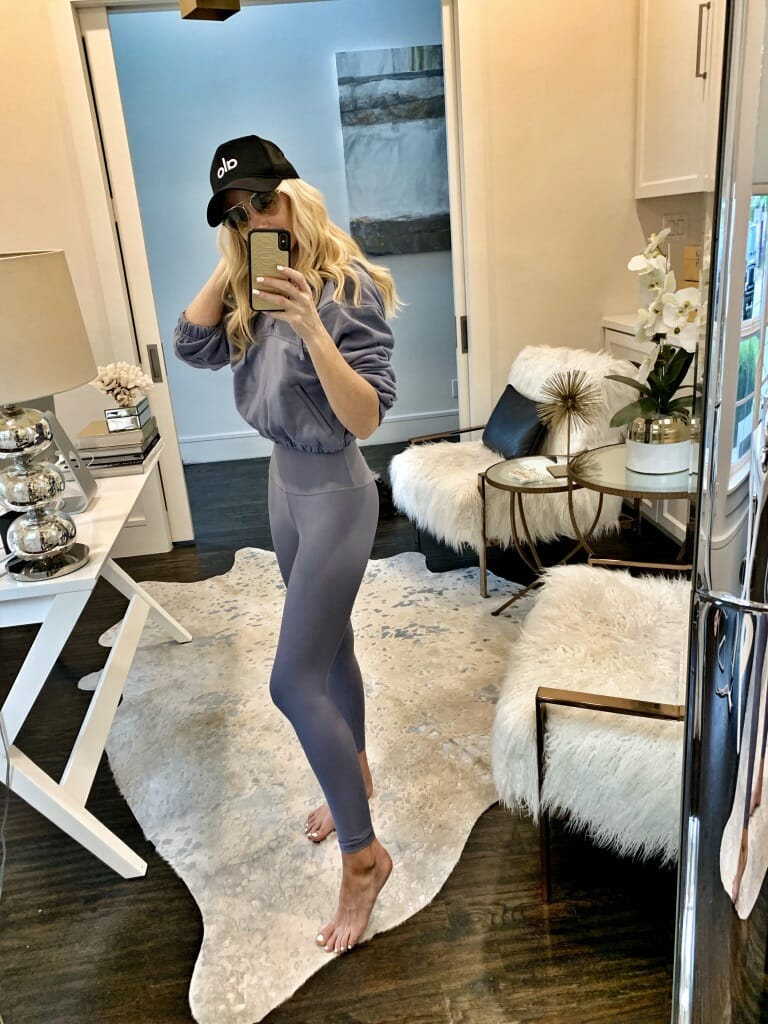 Style blogger wearing a blue sweatshirt and blue workout leggings