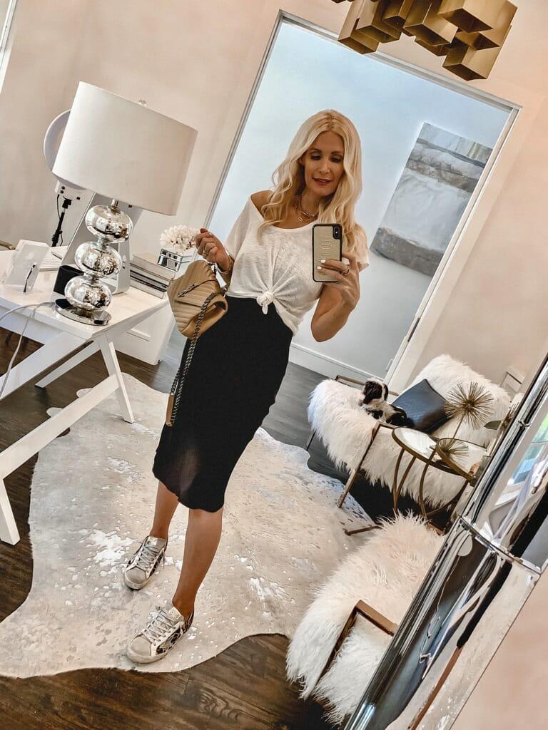 Dallas women wearing a black slip dress and a white tee
