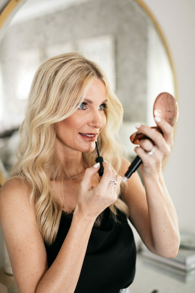 Fashion blogger wearing Charlotte Tilbury and Tom Ford beauty products