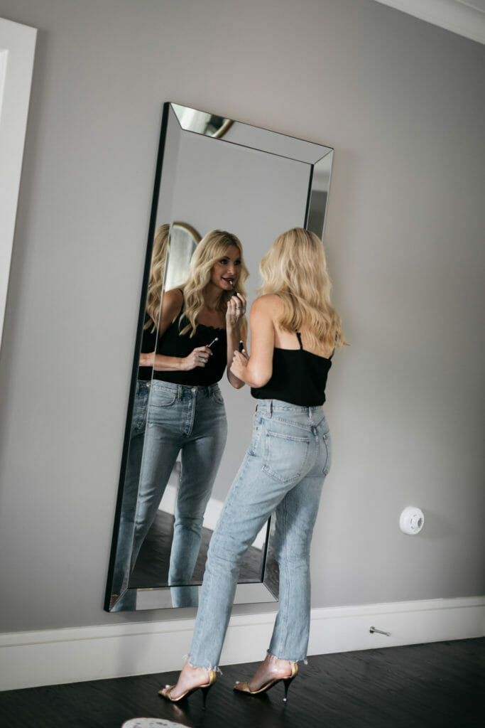 Dallas blogger wearing a black cami and light wash denim sharing favorite beauty products from Nordstrom