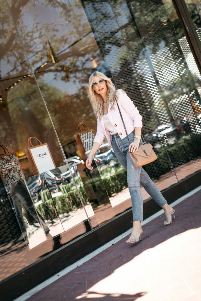 Dallas blogger wearing a pink blazer and YSL bag with denim