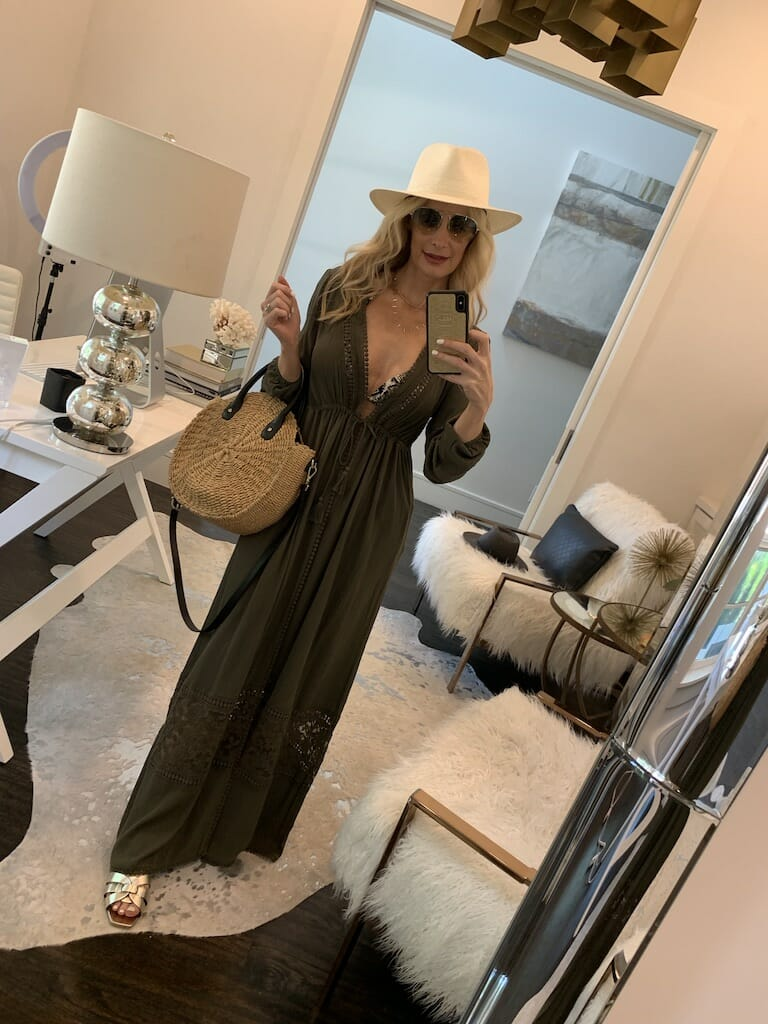 Dallas blogger wearing an olive green swimsuit maxi cover-up and gold summer flats
