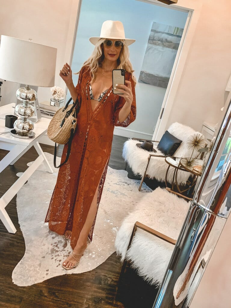Dallas fashion blogger wearing a rust colored swimsuit cover-up