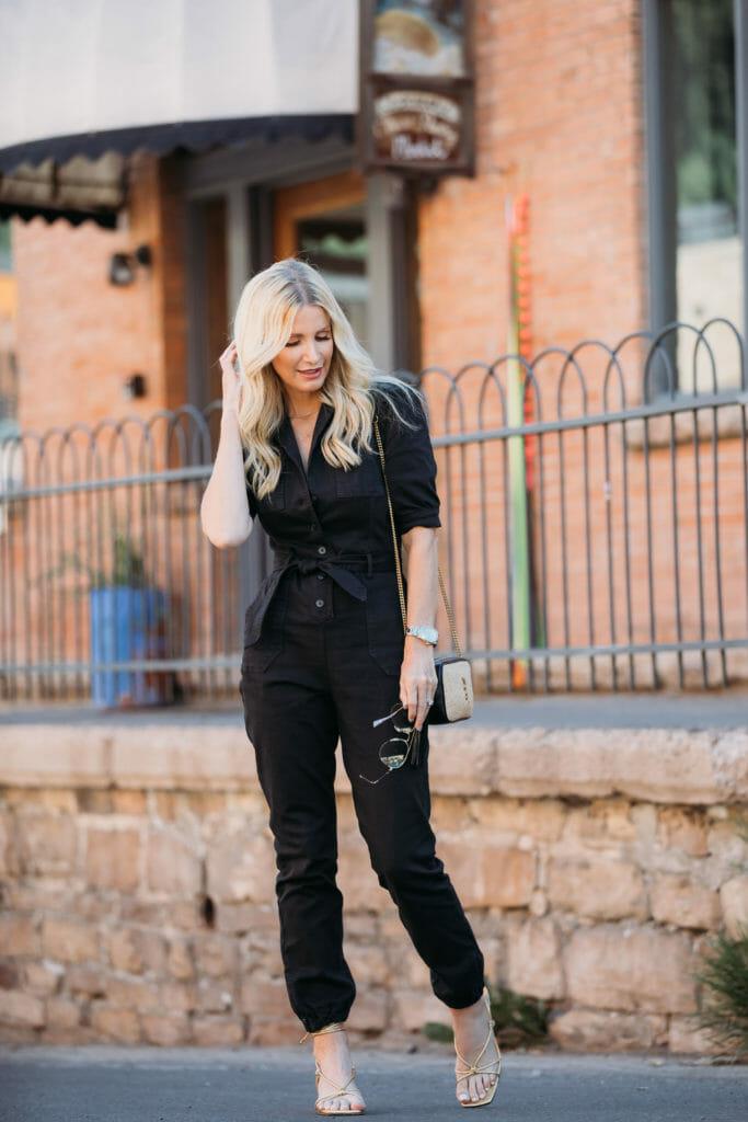 Dallas influencer wearing a black denim jumpsuit