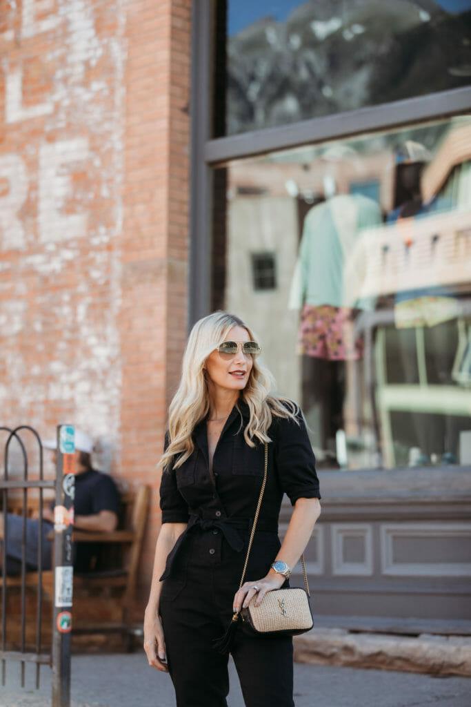 Dallas blogger carrying a YSL handbag