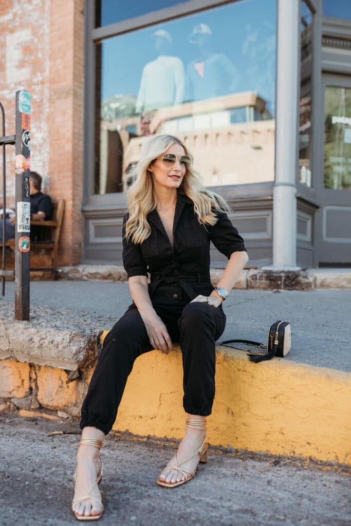 Dallas blogger wearing a black jumpsuit by Paige