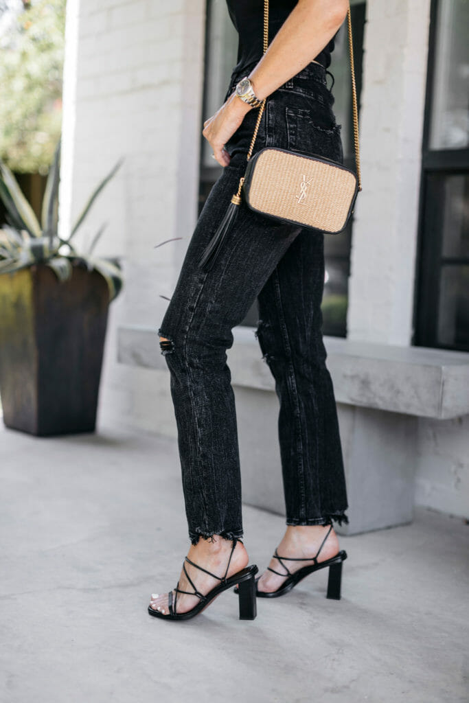 Dallas style influencer wearing a YSL handbag and black strappy sandals