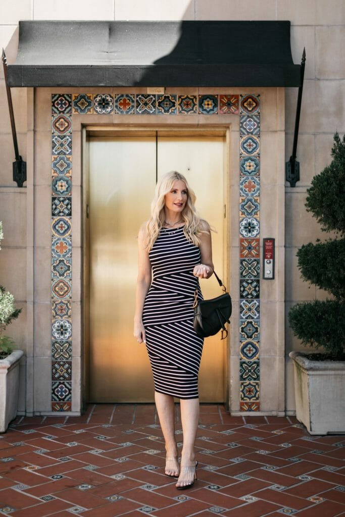 Dallas blogger wearing a black and white striped dress