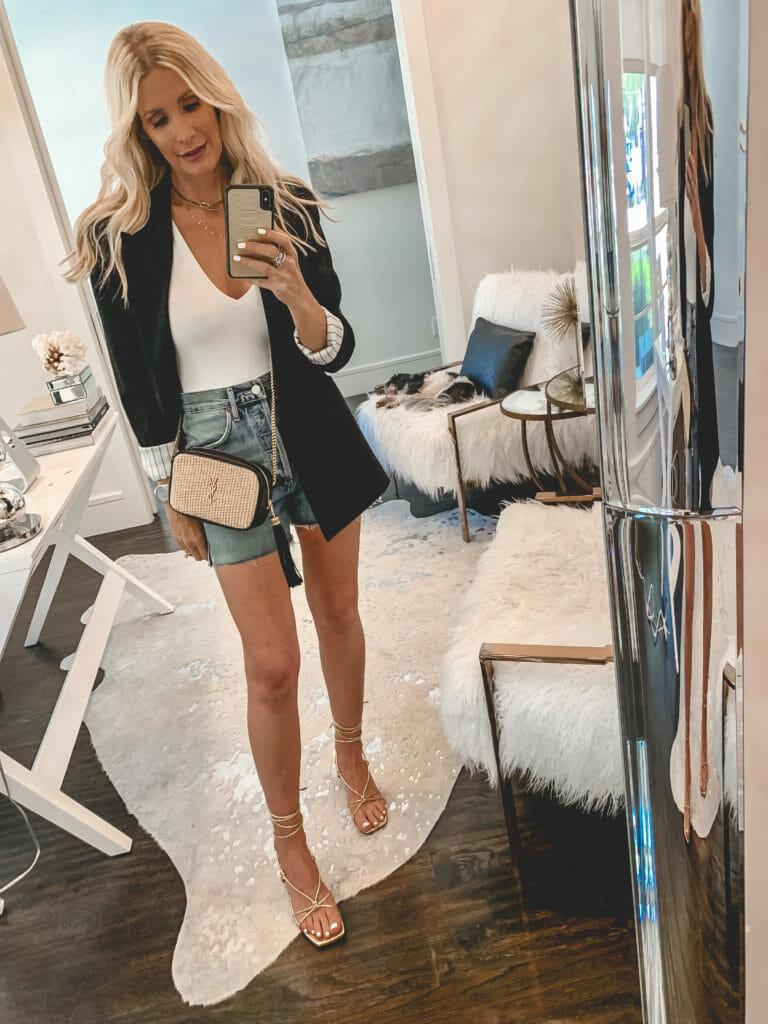 Dallas blogger wearing a black blazer and denim shorts