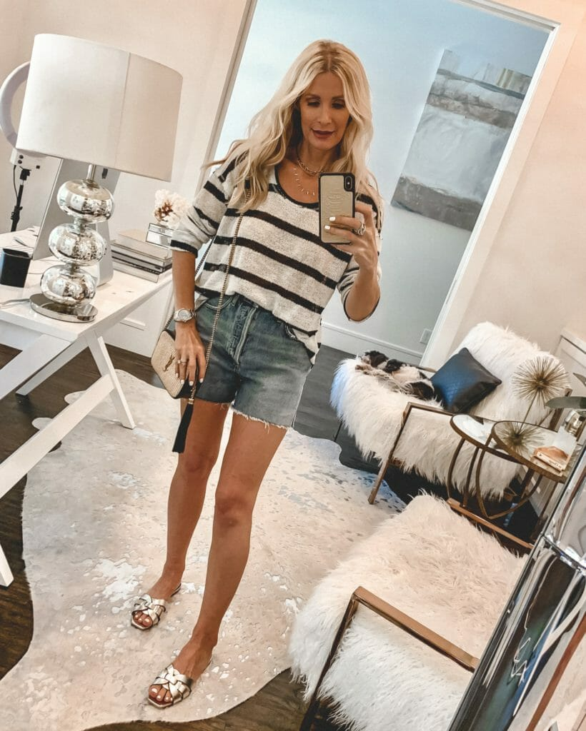 Dallas fashion blogger wearing a white and navy striped summer shirt with denim shorts