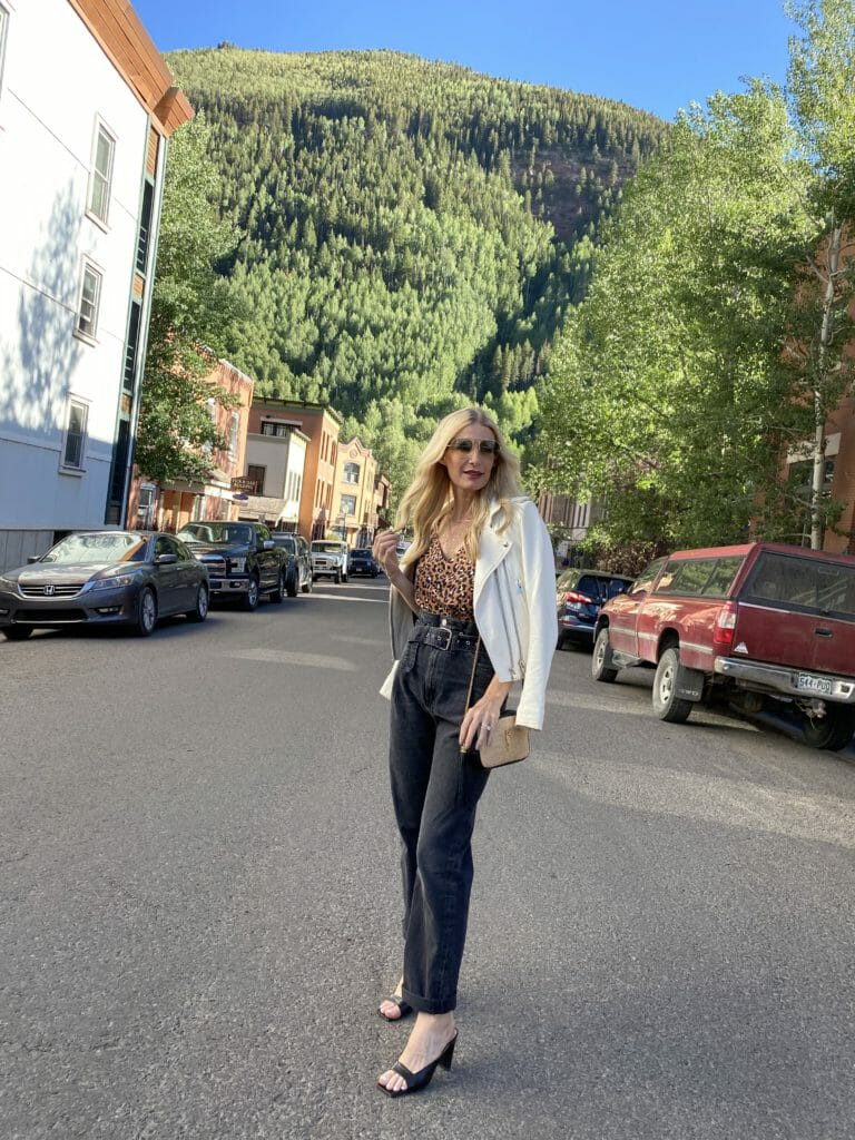 Fashion blogger wearing a leopard cami and black paper bag pants