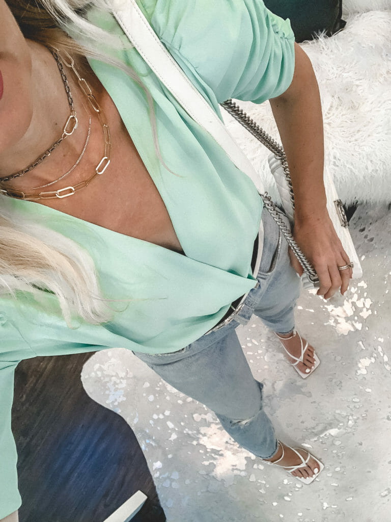 Dallas blogger wearing a mint summer bodysuit and gold accessories
