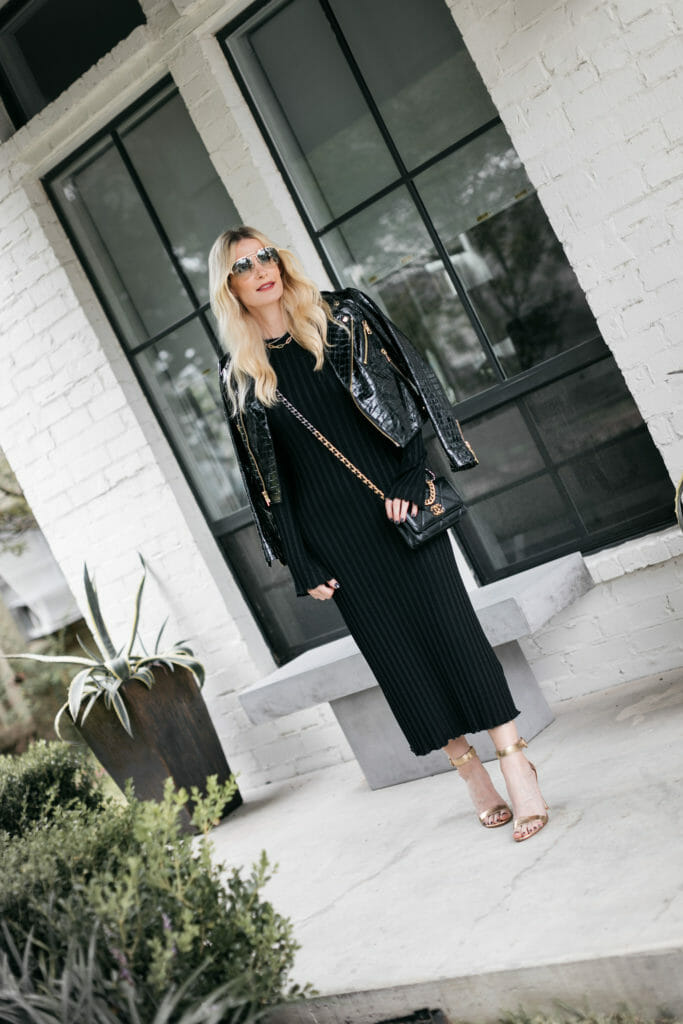 Style blogger wearing a black ribbed dress and a leather Moto jacket