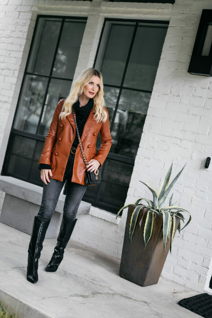 Dallas style blogger wearing a leather jacket and black denim