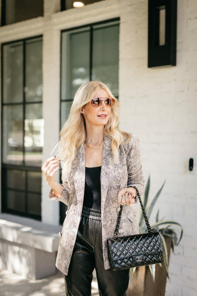 Dallas blogger wearing a black bodysuit and faux leather joggers