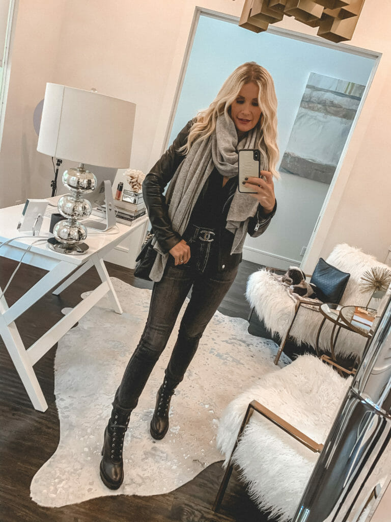 Style blogger wearing a cozy cashmere scarf and a leather jacket with combat boots