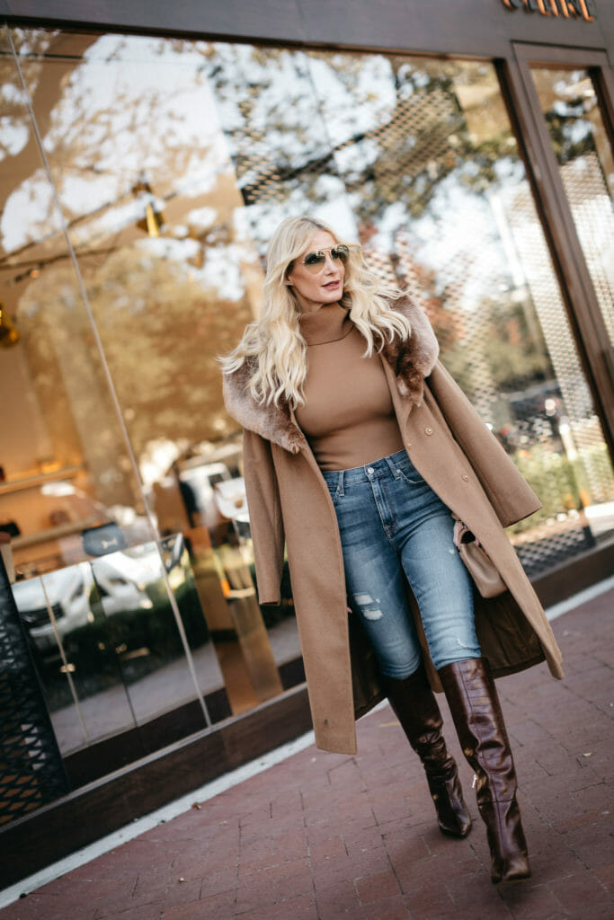 Dallas blogger wearing a turtleneck sweater and a fur hooded coat