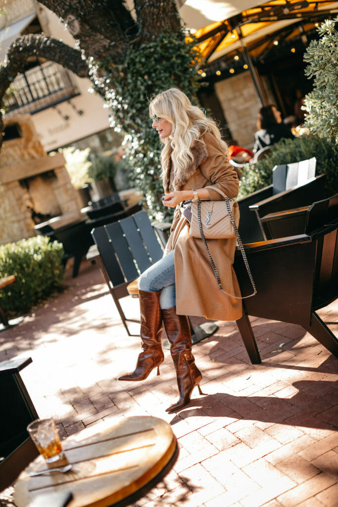 Dallas blogger wearing knee high brown boots and a light brown coat