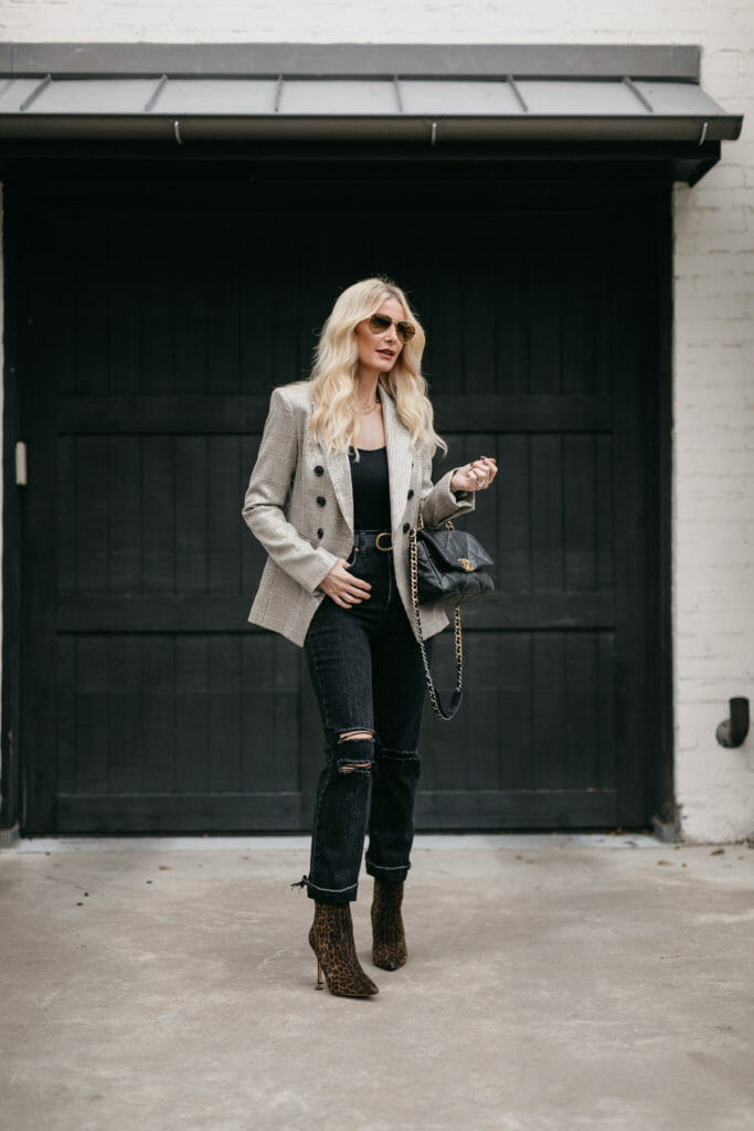 Dallas blogger wearing a Veronica Beard blazer and faded black denim with leopard booties