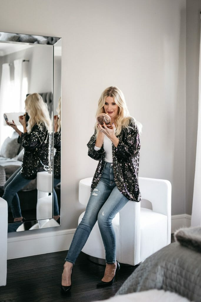 Dallas blogger wearing a black sparkle cardigan to wear on New Years Eve