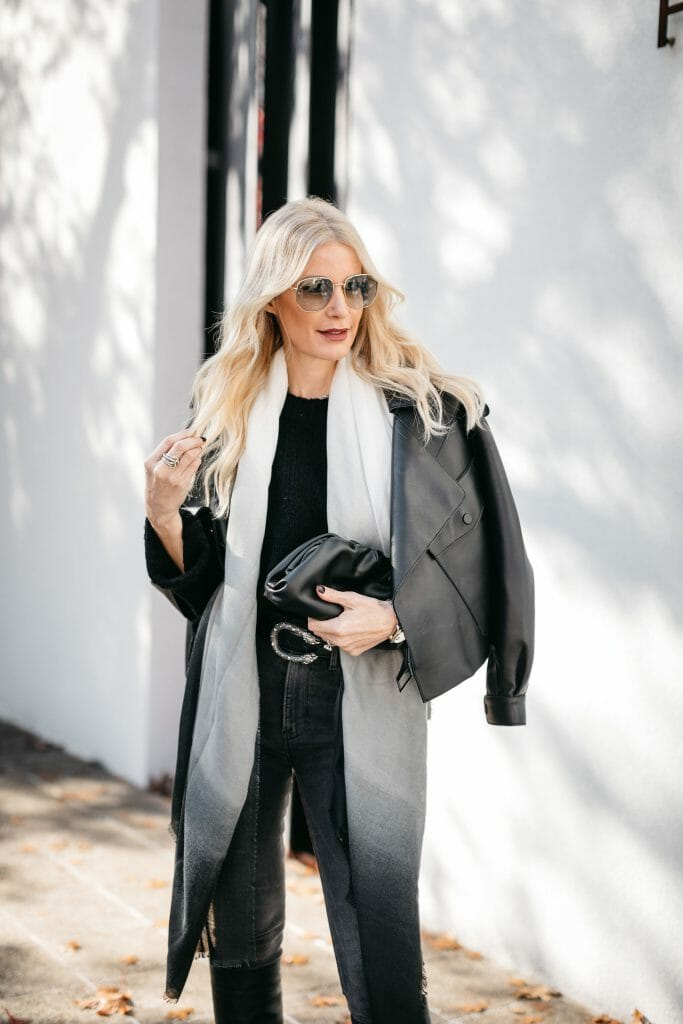Style blogger wearing a cozy chic look by Rachel Zoe and black denim