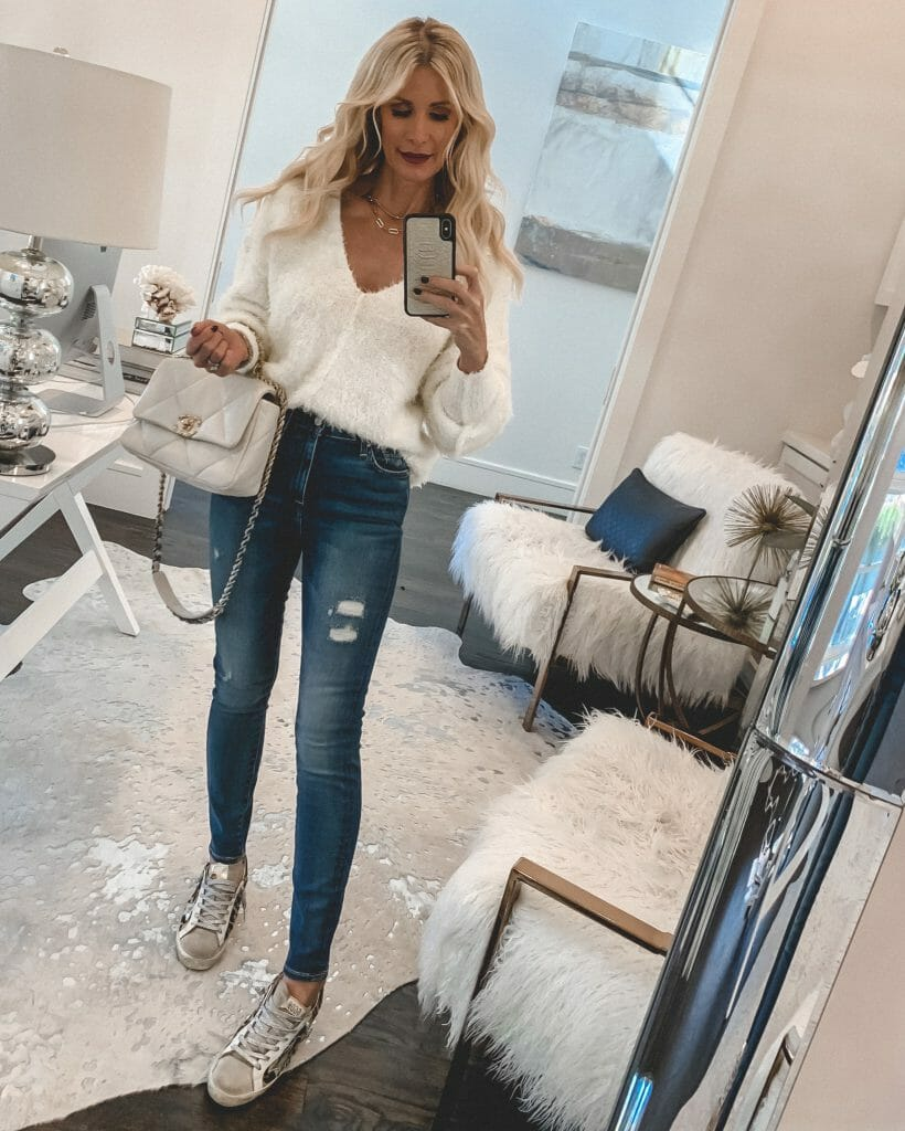 Dallas blogger sharing the best after Christmas sales 2020 and wearing a white sweater