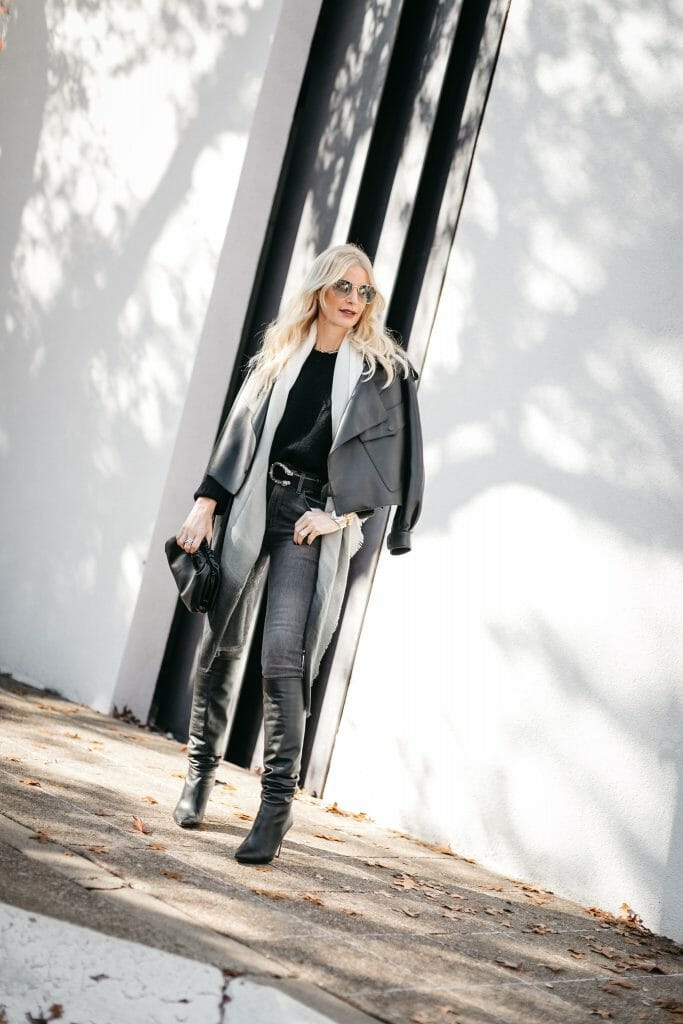 Dallas blogger wearing a black leather jacket and black leather boots
