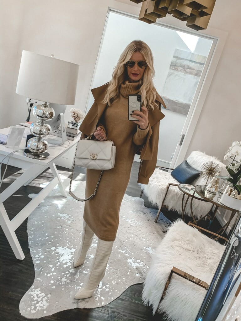 Dallas blogger wearing a camel sweater dress and white knee high boots