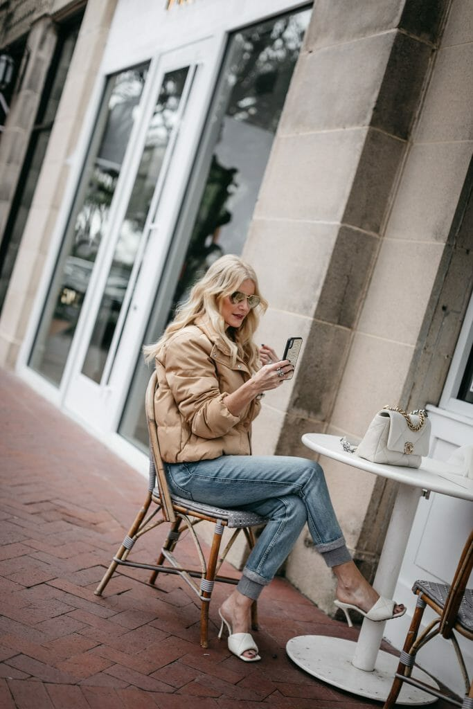 Dallas style blogger wearing chic denim joggers and a camel jacket for winter