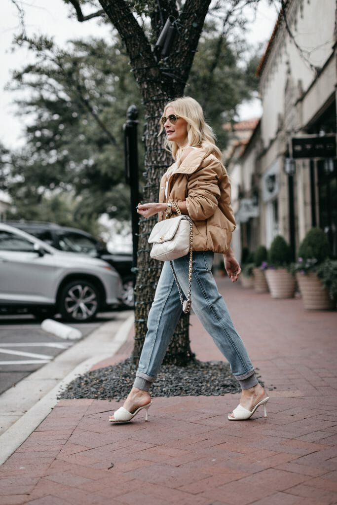 Dallas blogger wearing light wash denim and a camel puffer jacket