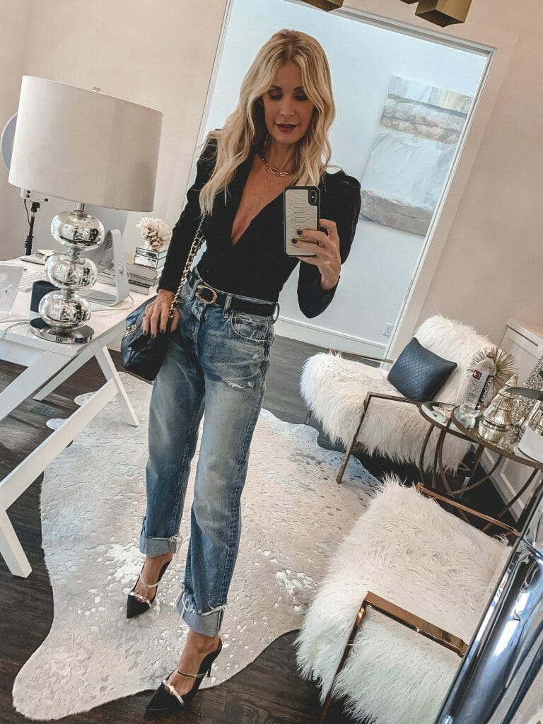 Dallas fashion blogger wearing a black long-sleeve bodysuit and baggy jeans