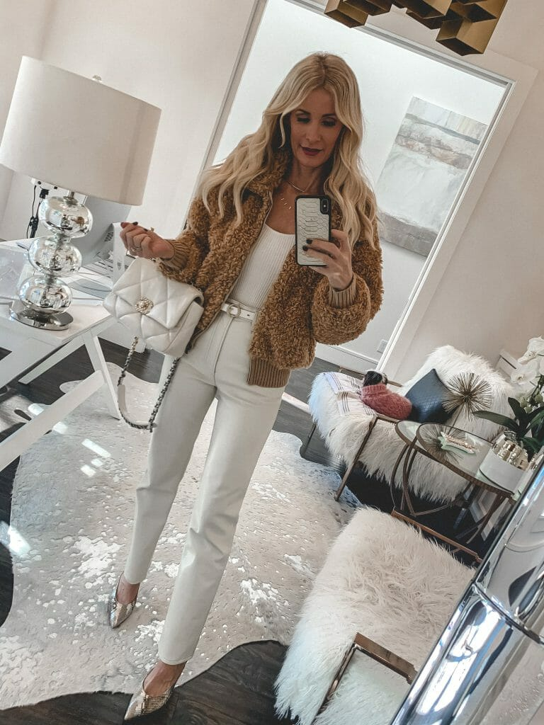 Dallas style blogger wearing a camel teddy coat and a white ribbed tank