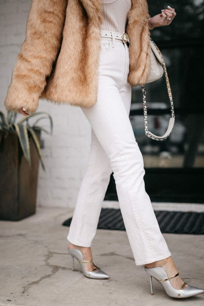 Dallas fashion blogger wearing white jeans and a faux fur jacket for winter