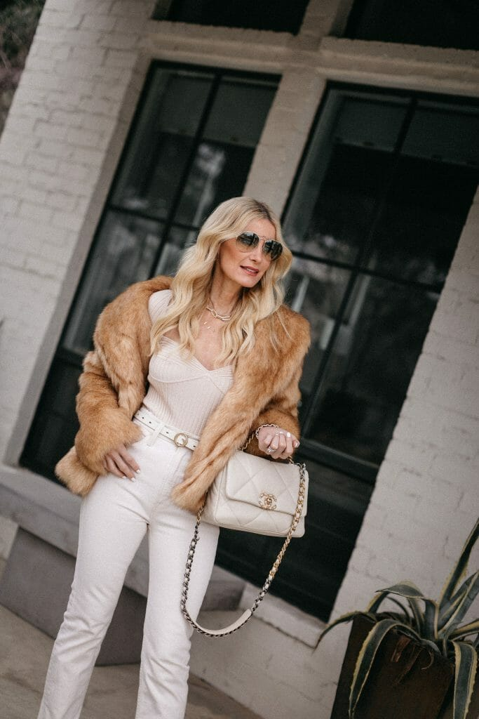 Fashion blogger wearing a faux fur camel jogger and a cream colored bodysuit
