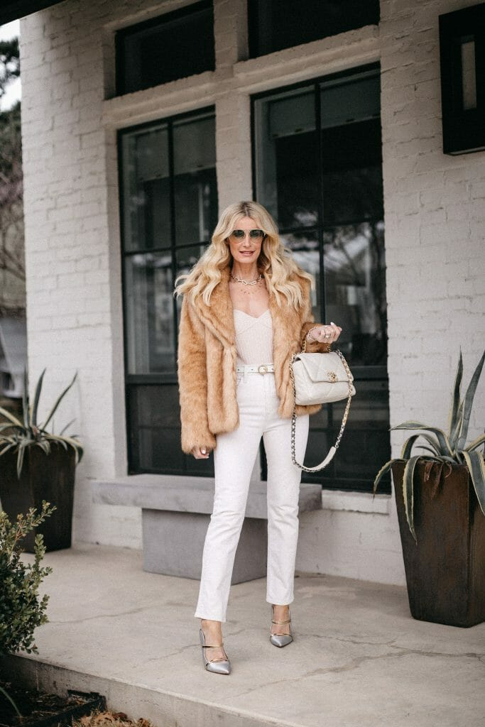 Dallas blogger waring white denim and a faux fur camel jacket