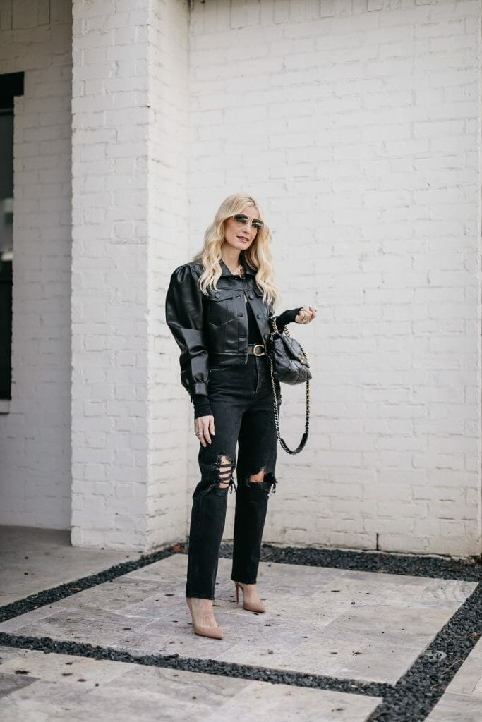 So Heather blog wearing a black puff sleeve faux leather jacket and black denim