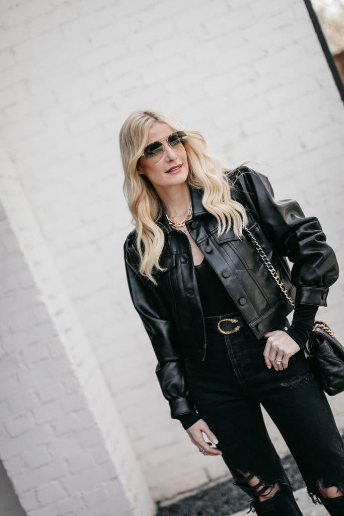 Dallas blogger wearing black denim and a black bodysuit