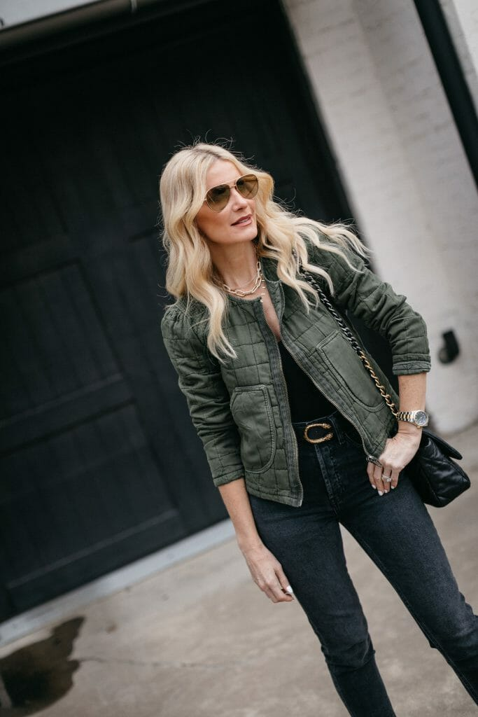 Dallas blogger wearing a black bodysuit and a quilted green jacket for a year round look