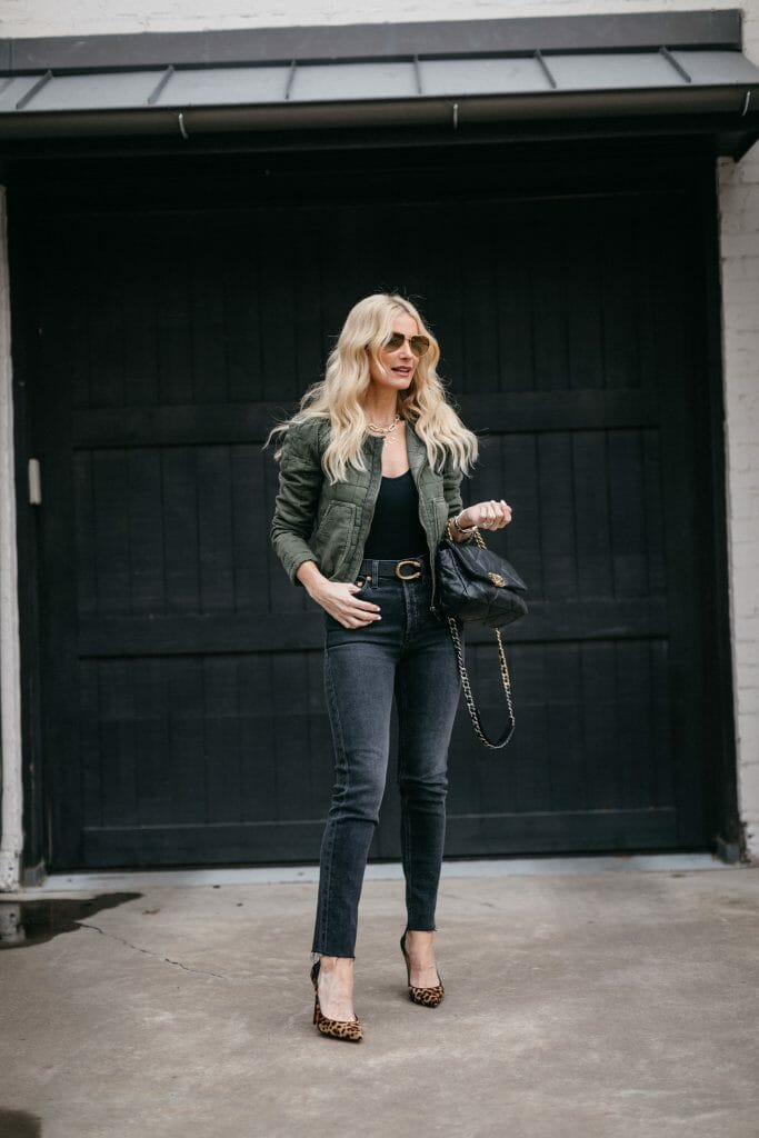 Dallas blogger wearing a green quilted jacket and black denim by Redone