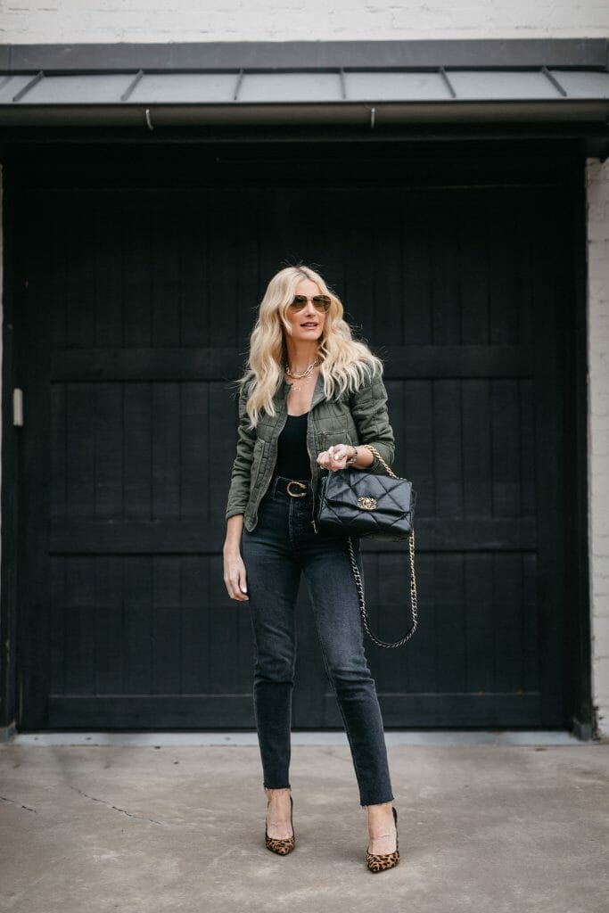 Dallas blogger wearing black Redone denim and a black bodysuit and a green jacket
