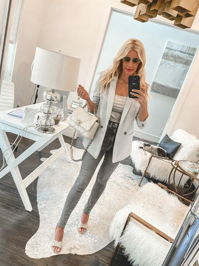 Dallas style blogger wearing grey denim and a light blue blazer for spring and Summer