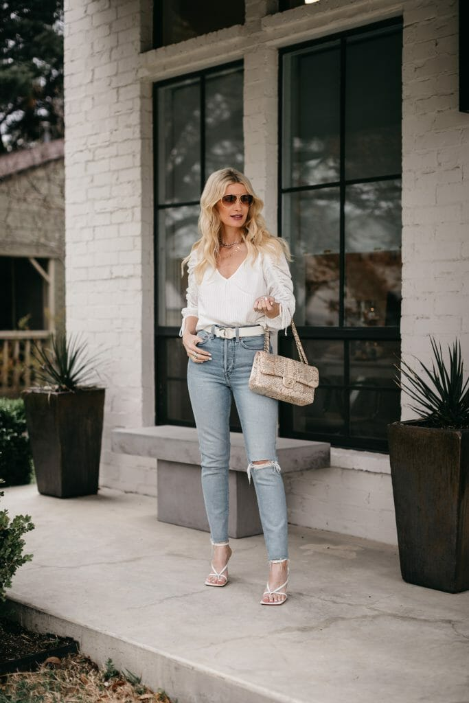 Dallas style blogger wearing Agolde denim and a ruched white top for summer