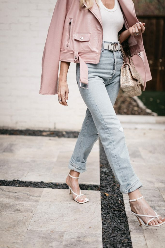 So Heather Blog wearing light wash denim and a pink leather jacket