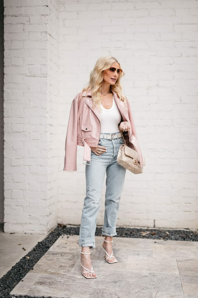 Dallas blogger wearing a white bodysuit and a pink leather jacket from Nordstrom