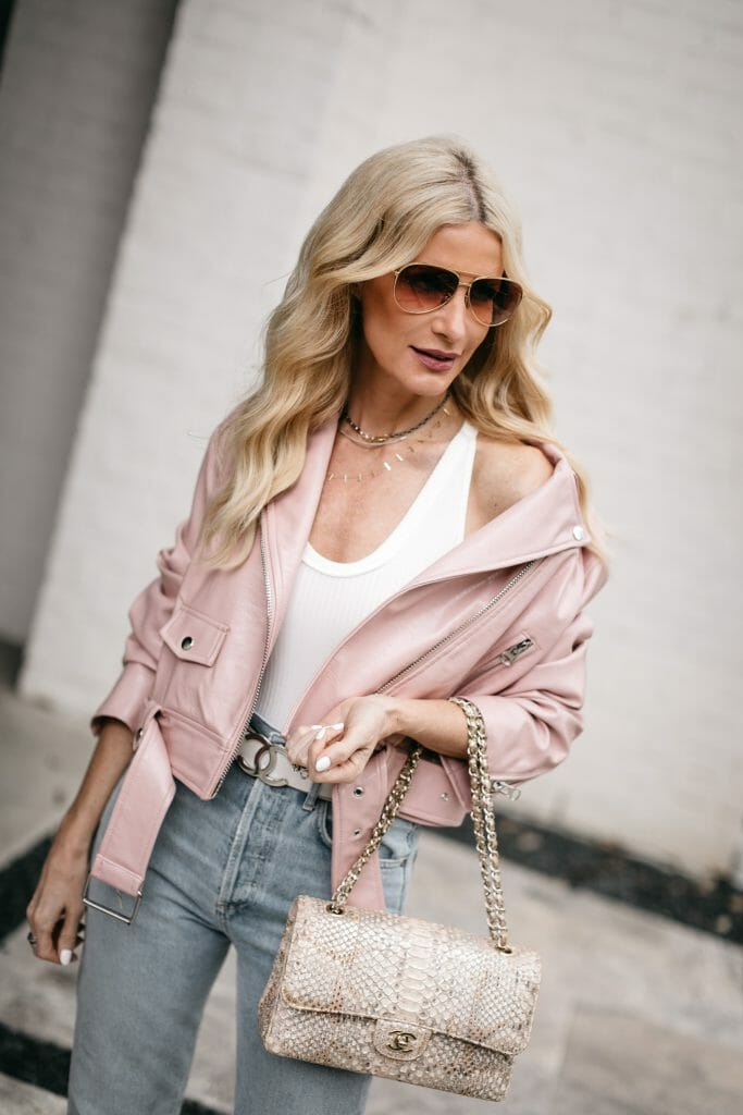 Dallas fashion blogger wearing a pink jacket and white bodysuit for spring and summer