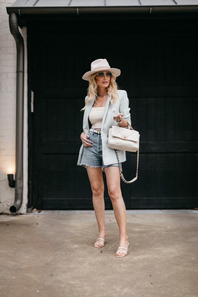 So Heather Blog fashion blogger wearing a light blue blazer and vintage denim shorts for spring