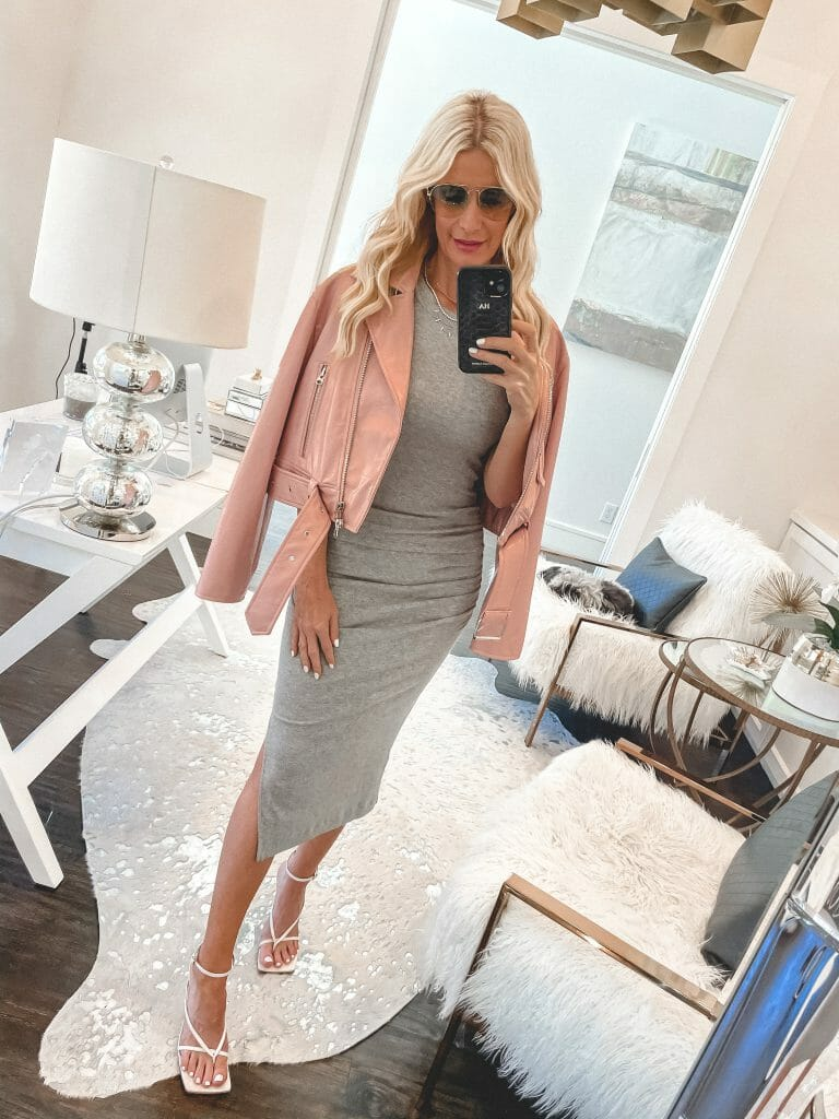 So Heather blog wearing a gray bodycon dress and pink leather jacket
