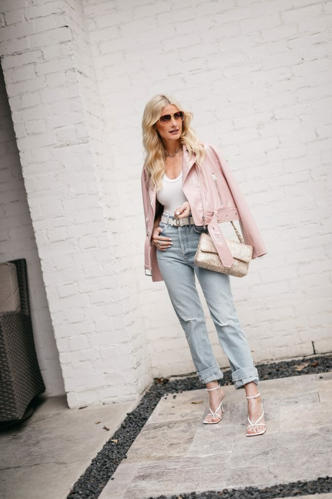 Dallas blogger wearing a pink leather jacket and light wash denim